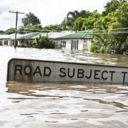 """Flooded """"Road subjet to Flooding"""" sign"""